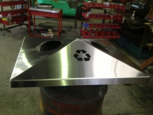 Stainless steel public bin top by Tait Stainless.